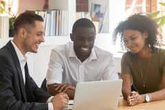 Insurance broker consulting african couple showing online presentation on laptop royalty free stock photography