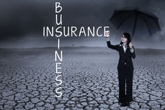 Insurance business. Business woman writing insurance concept on the air. shot outdoors Royalty Free Stock Photography