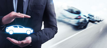 Insurance car. Man holds in his hands a car Royalty Free Stock Photography