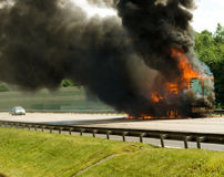Insurance case. With truck in fire ith black smoke Stock Photos