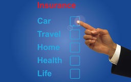 Insurance choices. Insurances choice listed in words on a blue touch computer screen, car travel, home, health and life  with man's forefinger pointing to car Stock Image