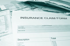 Insurance claim form and bills Stock Photos