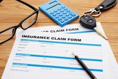 Insurance claim form with car key Royalty Free Stock Photos