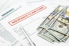 Insurance claim form and money Royalty Free Stock Photo