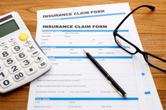 Insurance claim form with pen and calculator Stock Photo