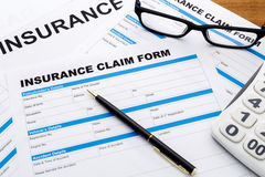 Insurance claim form with pen Stock Image