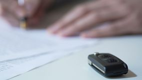 Insurance company employee signing car rental contract, affordable vehicle