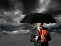 Insurance concept. With business man and umbrella