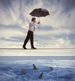 Insurance concept. Concept of insurance with businessman on the rope Royalty Free Stock Photos