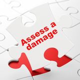 Insurance concept: Assess A Damage on puzzle background. Insurance concept: Assess A Damage on White puzzle pieces background, 3D rendering Royalty Free Stock Photography