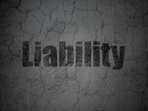 Insurance concept: Liability on grunge wall background. Insurance concept: Black Liability on grunge textured concrete wall background Royalty Free Stock Photo