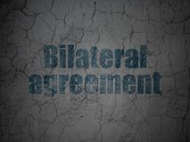 Insurance concept: Bilateral Agreement on grunge wall background. Insurance concept: Blue Bilateral Agreement on grunge textured concrete wall background Royalty Free Stock Photos
