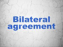 Insurance concept: Bilateral Agreement on wall background. Insurance concept: Blue Bilateral Agreement on textured concrete wall background Royalty Free Stock Photography