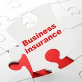 Insurance concept: Business Insurance on puzzle background Stock Photography