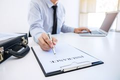 Insurance concept, businessman signing a car insurance policy.  Royalty Free Stock Photo
