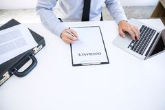 Insurance concept, businessman signing a car insurance policy.  Stock Photo