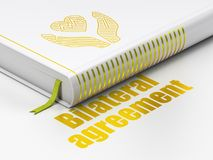 Insurance concept: book Heart And Palm, Bilateral Agreement on white background. Insurance concept: closed book with Gold Heart And Palm icon and text Bilateral Royalty Free Stock Image