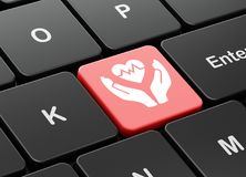 Insurance concept: Heart And Palm on computer keyboard background. Insurance concept: computer keyboard with Heart And Palm icon on enter button background, 3D Stock Photography