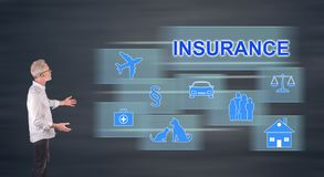 An insurance concept explained by a businessman on a wall screen. Businessman showing an insurance concept on a wall screen royalty free stock image