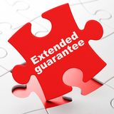 Insurance concept: Extended Guarantee on puzzle background. Insurance concept: Extended Guarantee on Red puzzle pieces background, 3D rendering Royalty Free Stock Images