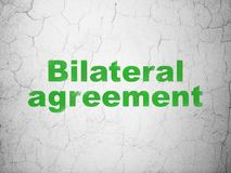 Insurance concept: Bilateral Agreement on wall background. Insurance concept: Green Bilateral Agreement on textured concrete wall background Stock Image