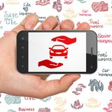 Insurance concept: Hand Holding Smartphone with Car And Palm on display. Insurance concept: Hand Holding Smartphone with  red Car And Palm icon on display,  Hand Royalty Free Stock Image