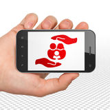 Insurance concept: Hand Holding Smartphone with Family And Palm on display. Insurance concept: Hand Holding Smartphone with  red Family And Palm icon on display Royalty Free Stock Image