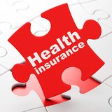 Insurance concept: Health Insurance on puzzle background. Insurance concept: Health Insurance on Red puzzle pieces background, 3D rendering Stock Photos