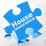 Insurance concept: House Insurance on puzzle background Stock Images