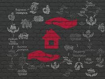 Insurance concept: House And Palm on wall background. Insurance concept: Painted red House And Palm icon on Black Brick wall background with Scheme Of Hand Drawn Royalty Free Stock Images