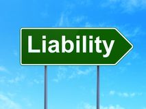 Insurance concept: Liability on road sign background. Insurance concept: Liability on green road highway sign, clear blue sky background, 3D rendering Stock Images