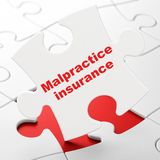 Insurance concept: Malpractice Insurance on puzzle background. Insurance concept: Malpractice Insurance on White puzzle pieces background, 3D rendering Royalty Free Stock Images