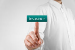 Insurance concept. Man click on virtual button with text insurance stock photo