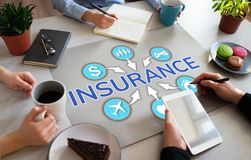 Insurance concept on office desktop life health care money travel. stock photos