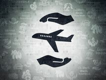 Insurance concept: Airplane And Palm on Digital Data Paper background. Insurance concept: Painted black Airplane And Palm icon on Digital Data Paper background Royalty Free Stock Photo