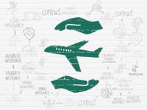Insurance concept: Airplane And Palm on wall background. Insurance concept: Painted green Airplane And Palm icon on White Brick wall background with Scheme Of Stock Photos