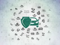 Insurance concept: Car And Shield on Digital Data Paper background. Insurance concept: Painted green Car And Shield icon on Digital Data Paper background with Royalty Free Stock Images