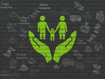 Insurance concept: Family And Palm on wall background. Insurance concept: Painted green Family And Palm icon on Black Brick wall background with Scheme Of Hand Stock Photos