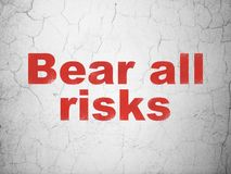 Insurance concept: Bear All Risks on wall background. Insurance concept: Red Bear All Risks on textured concrete wall background Stock Image
