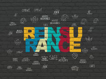 Insurance concept: Reinsurance on wall background Stock Photos