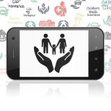 Insurance concept: Smartphone with Family And Palm on display Stock Photos