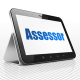 Insurance concept: Tablet Computer with Assessor on display Royalty Free Stock Photos
