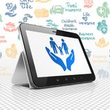 Insurance concept: Tablet Computer with Family And Palm on display. Insurance concept: Tablet Computer with  blue Family And Palm icon on display,  Hand Drawn Royalty Free Stock Photo
