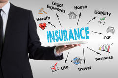 Insurance concept with young man holding a tablet computer Royalty Free Stock Photos