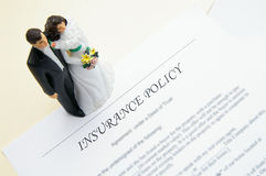 Insurance couple. Wedding couple and insurance plan Stock Images