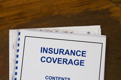 Insurance coverage. Abstract with blueprints and coffee Stock Image