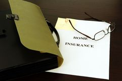 Insurance file. Preparing the insurance file; key, glasses and papers Stock Images