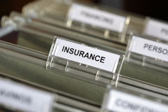 Insurance files. Inside of a filing cabinet with green folders and focus on insurance label Royalty Free Stock Images