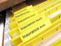 Insurance folders in cabinet. Open file cabinet showing insurance files
