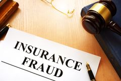 Insurance fraud written on a documents. Insurance fraud written on a documents and gavel royalty free stock images